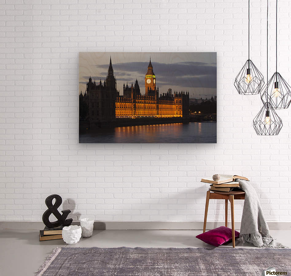 A Building And Clock Tower Along The Water's Edge Illuminated At Dusk; London, England  Wood print