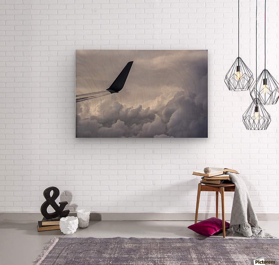 A commercial jet flies above the clouds over Illinois; United States of America  Wood print