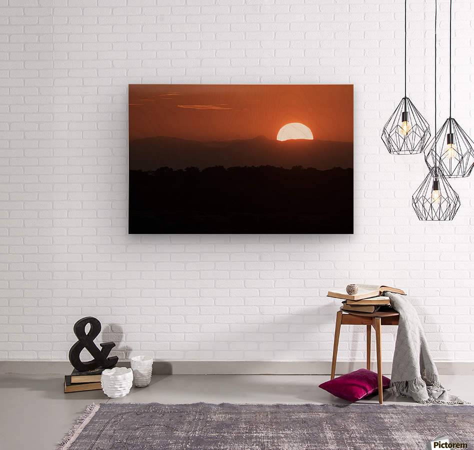 Setting sun overtop of the African landscape; South Africa  Wood print