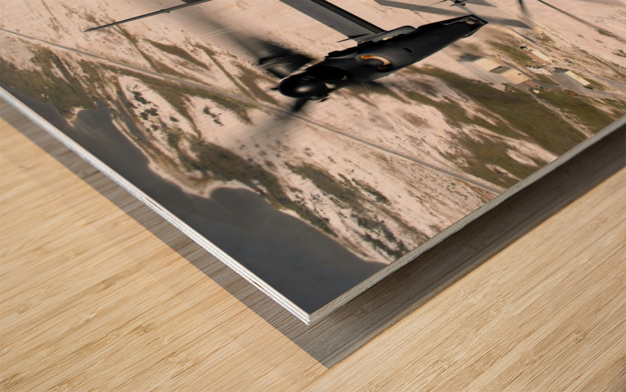 A CV-22 Osprey and an MH-53 Pave Low fly over the coastline of Florida. Wood print