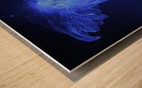 Glowing blue jellyfish in the dark water Wood print