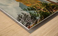 Wooden hedge blocks, falling autumn leaves, the water surface of the pond Wood print