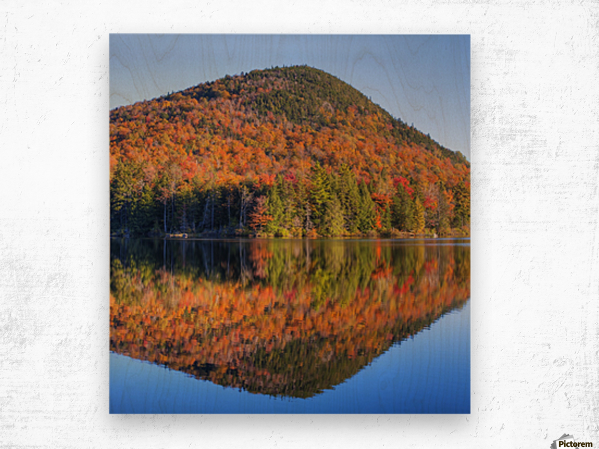 Mountain reflected in Sugarloaf pond in autumn; Quebec, Canada Wood print