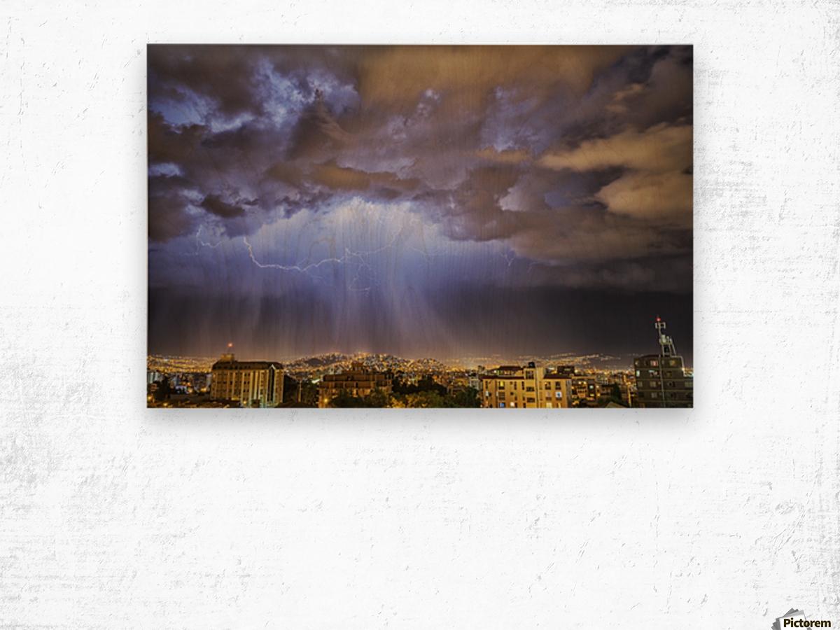 Lightning lights up the night skies above the city of Cochabamba; Cochabamba, Bolivia Wood print