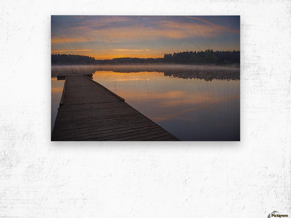 Reflection of a beautiful serene sunrise on peaceful Scott lake; Washington, United States of America Wood print