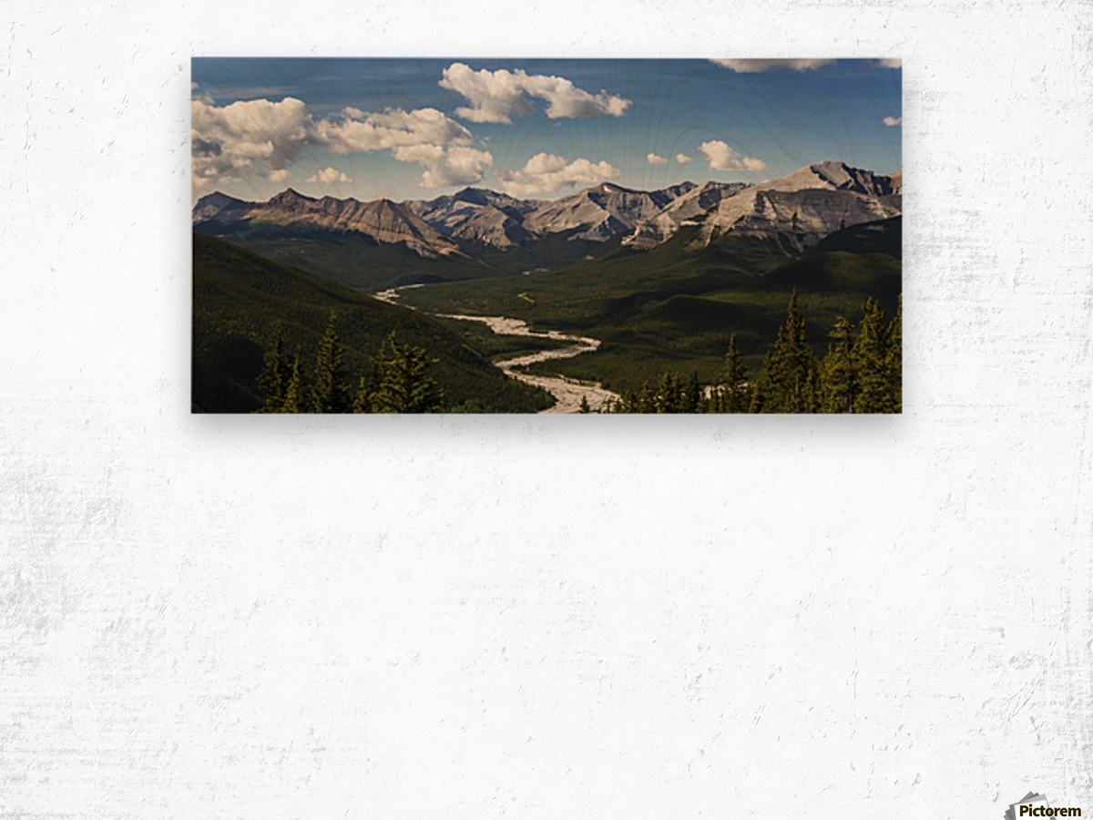 Panorama of river valley and mountain range with blue sky and clouds; Bragg Creek, Alberta, Canada Wood print