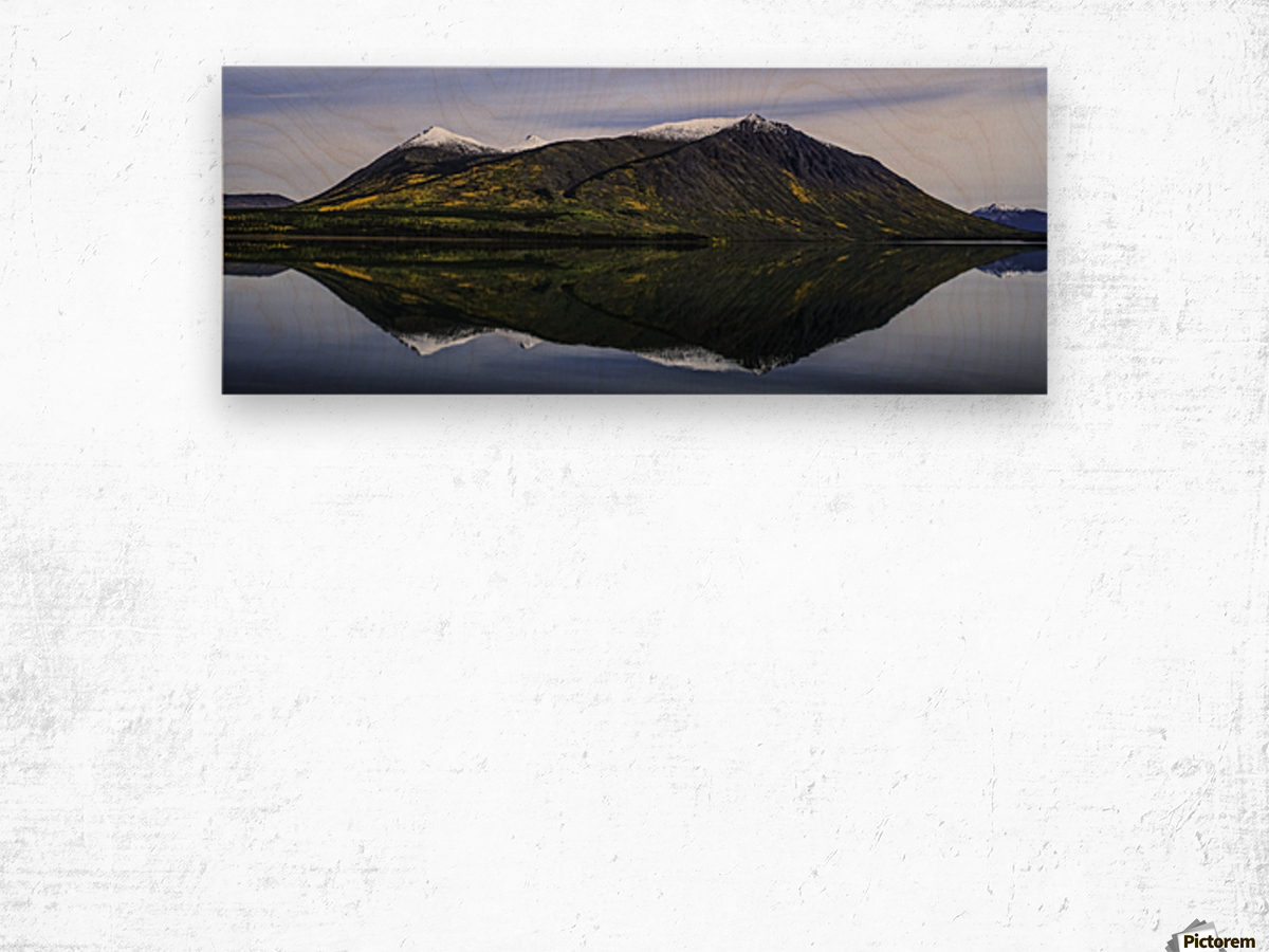 Reflection of the mountains surrounding Carcross reflected in the still waters; Yukon, Canada Wood print