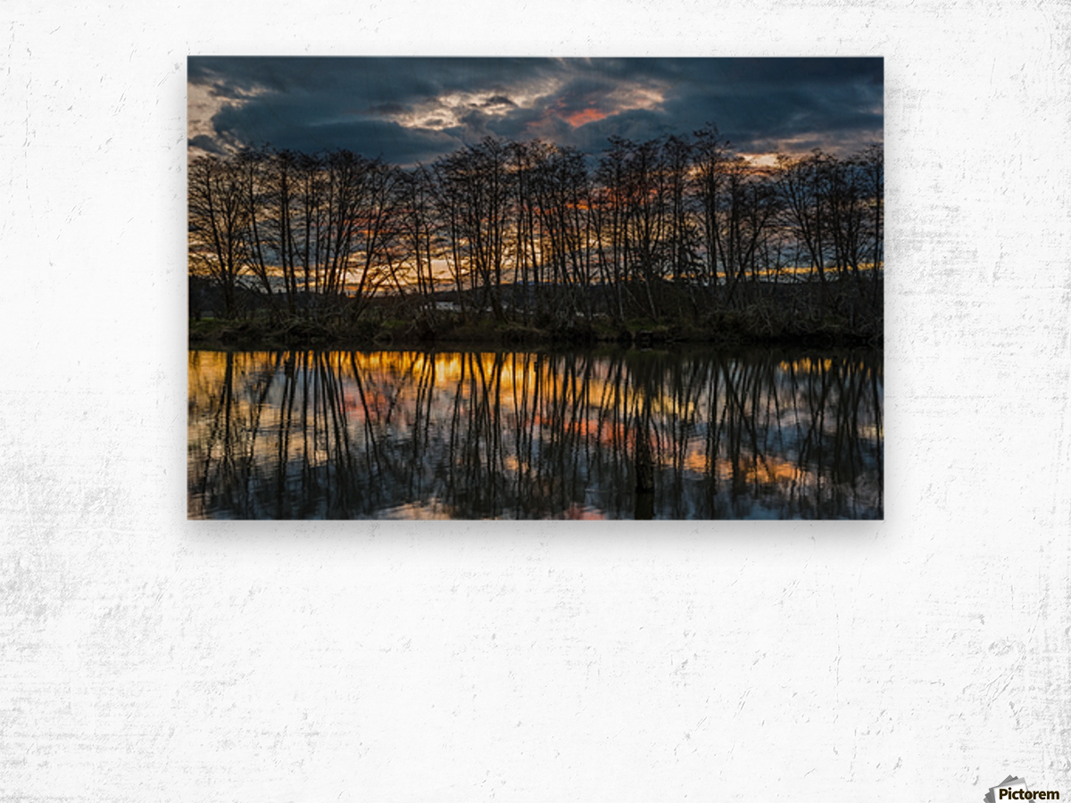The sun rises along the Lewis and Clark River; Astoria, Oregon, United States of America Wood print