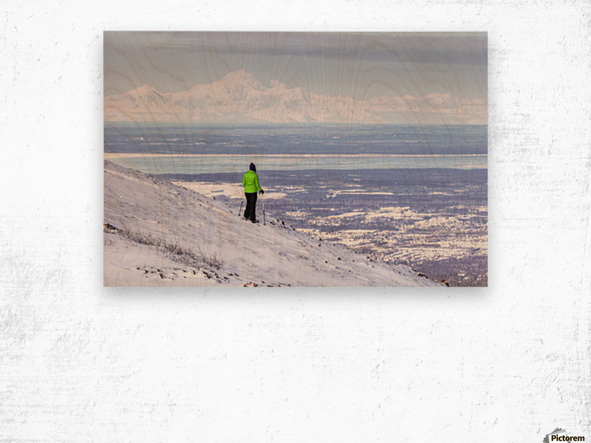 Woman snowshoer taking in the view of Mt. McKinley (Denali) from Blueberry Hill at the Glen Alps area of Chugach State Park, Anchorage, Southcentral Alaska, Winter, HDR Wood print
