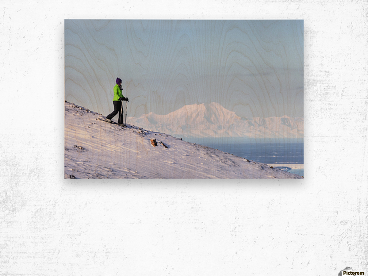 Woman snowshoeing on Blueberry Hill at the Glen Alps area of Chugach State Park with Mt. Foraker in the background, Anchorage, Southcentral Alaska, Winter, HDR Wood print