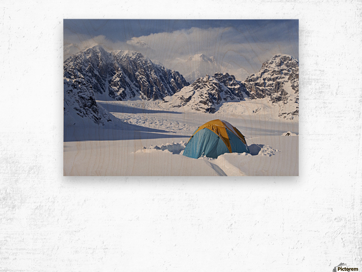 Mountain tent on ridge in winter, Mt. McKinley in background, part of Mt. Dan Beard immediately behind tent, Denali National Park and Preserve; Alaska, United States of America Wood print