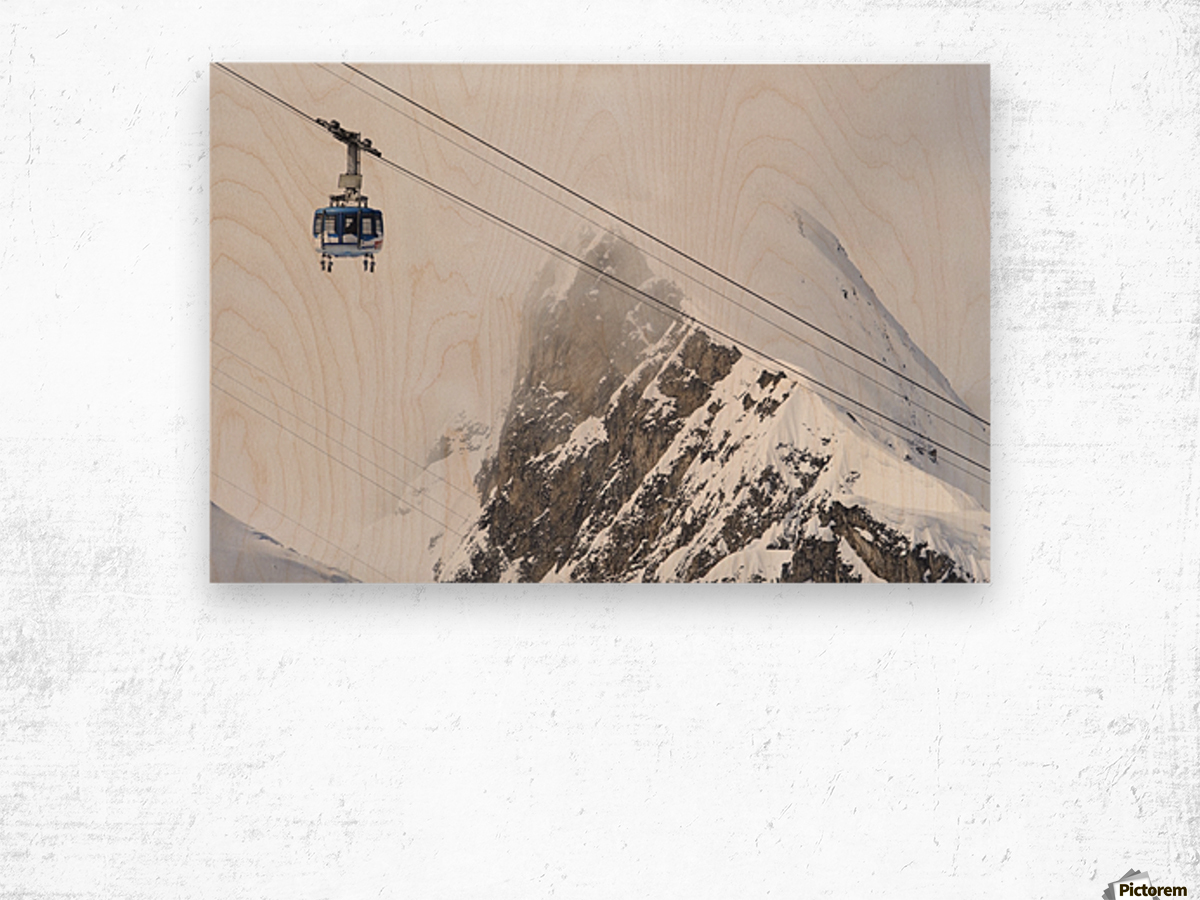 Scenic view of the Titlis Rotair revolving circular tram at Engelberg Resort in Switzerland Wood print