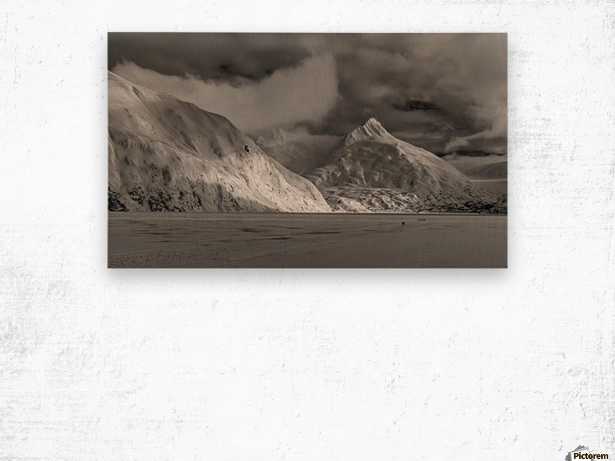 Hikers make the trek to Portage Glacier on Portage Lake in winter, South-central Alaska; Alaska, United States of America Wood print