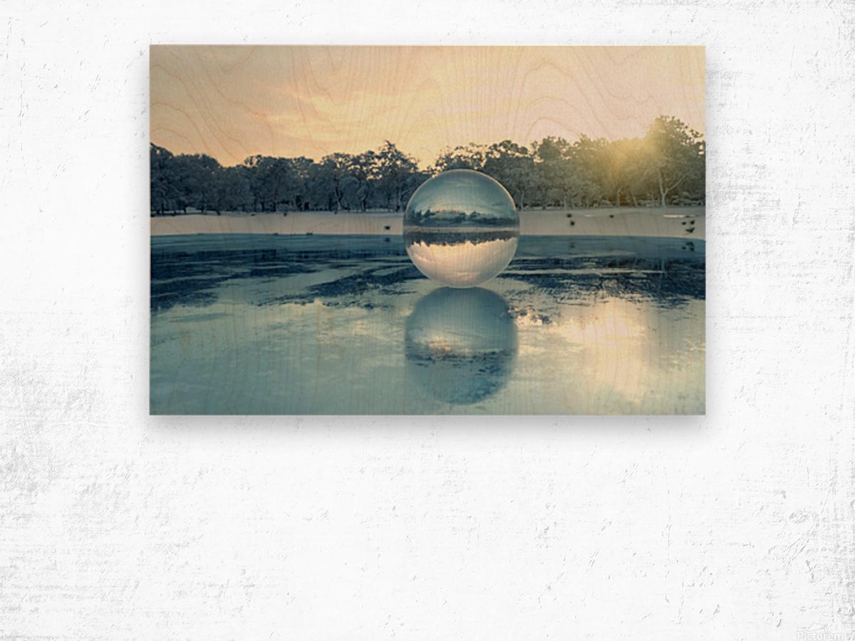 crystal ball on frozen lake Wood print