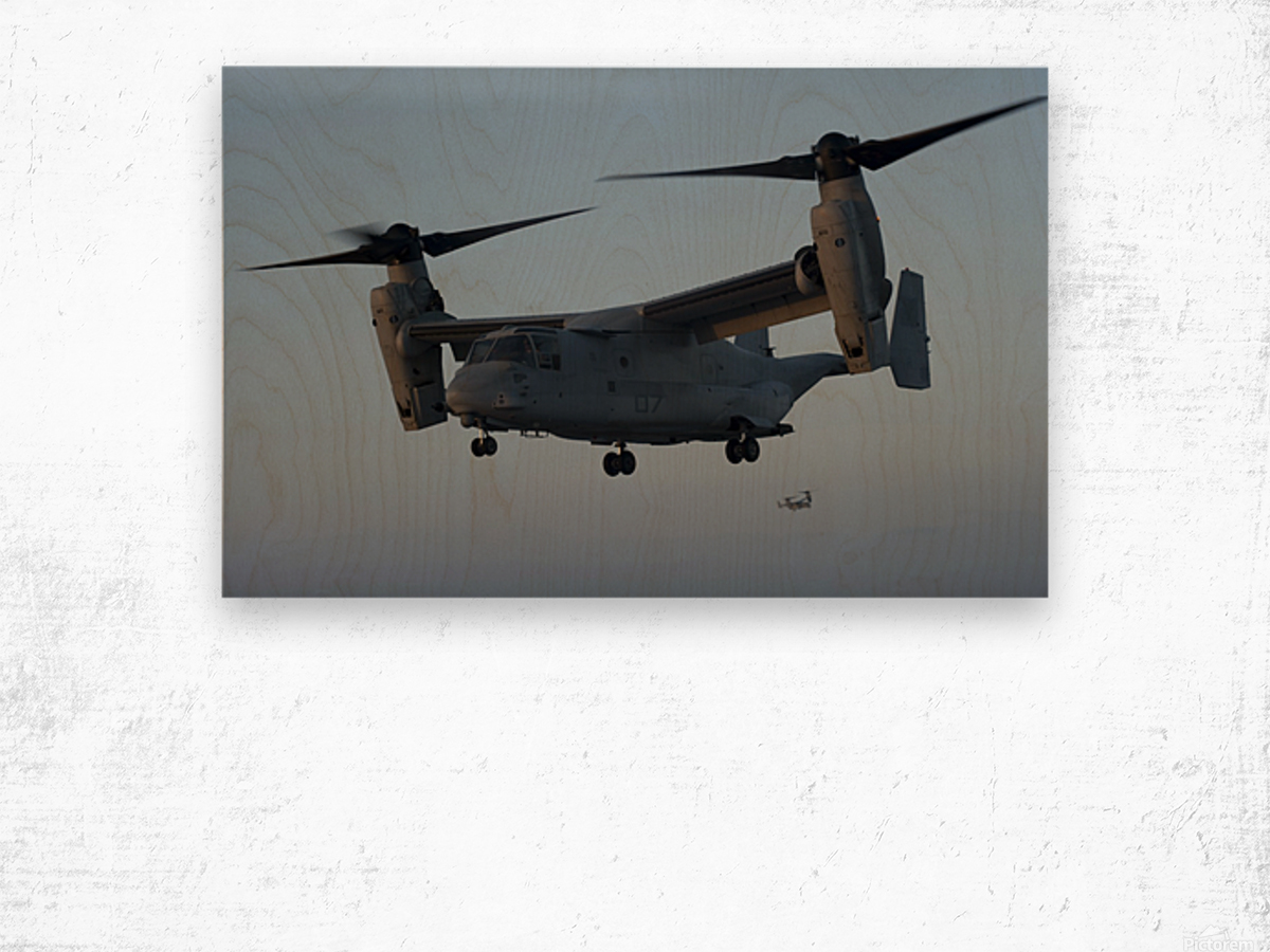 An MV-22 Osprey prepares to land on the flight deck of USS Anchorage. Wood print