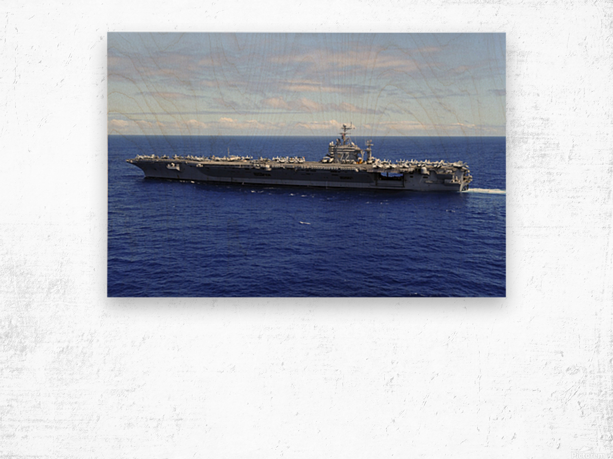 The aircraft carrier USS Abraham Lincoln transits across the Pacific Ocean. Wood print
