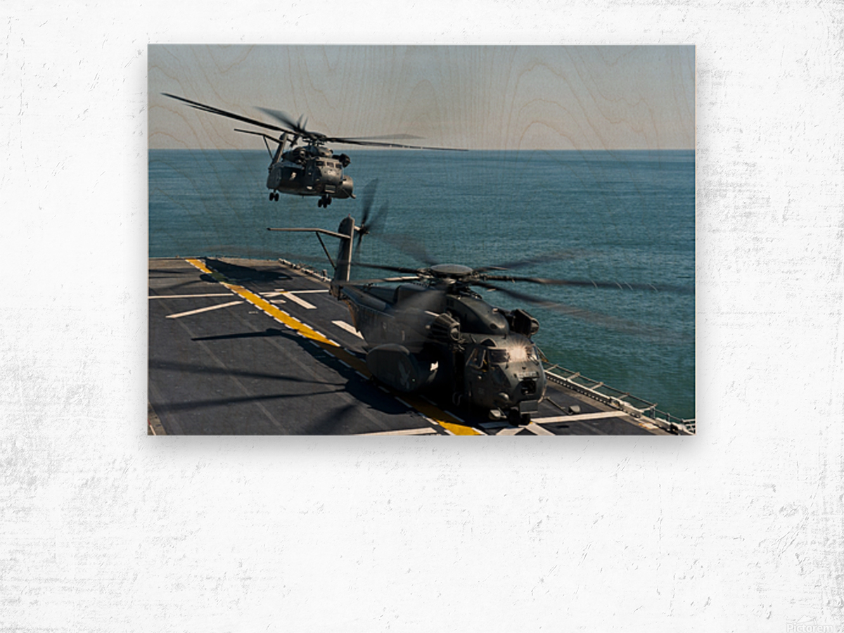 MH-53E Sea Dragon helicopters take off from the flight deck of USS Wasp. Wood print