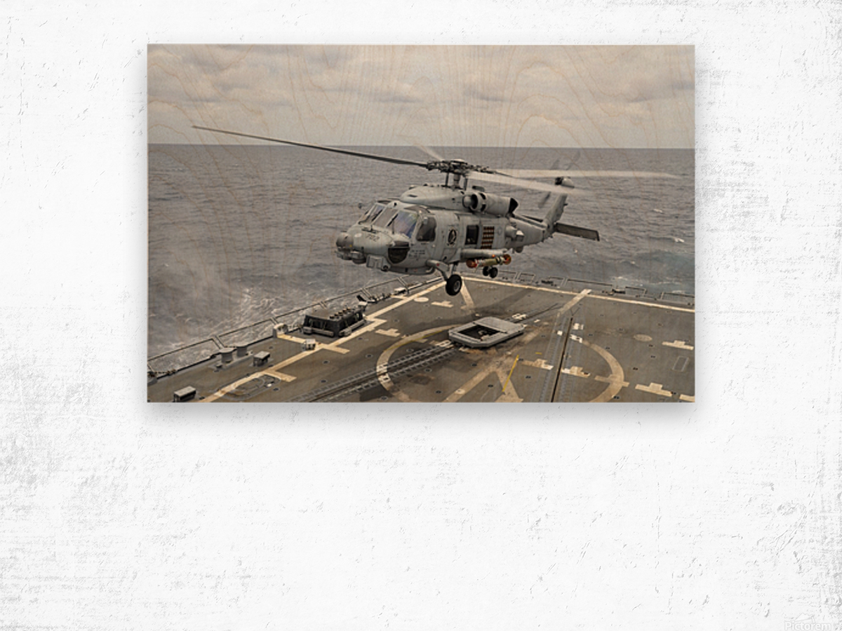 An MH-60R Sea Hawk helicopter lifts off from USS Wayne E. Meyer. Wood print