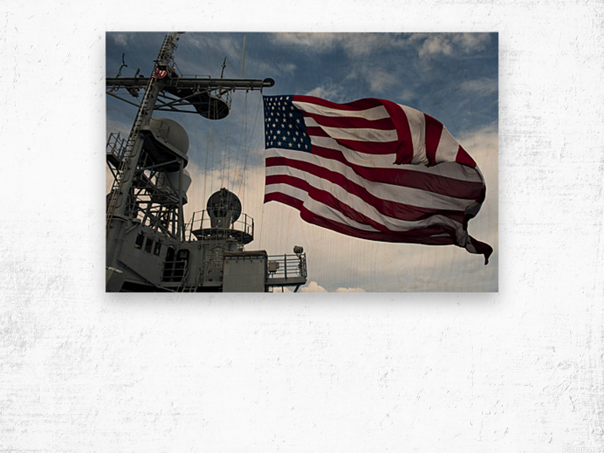 USS Cowpens flies a large American flag during a live fire weapons shoot. Wood print