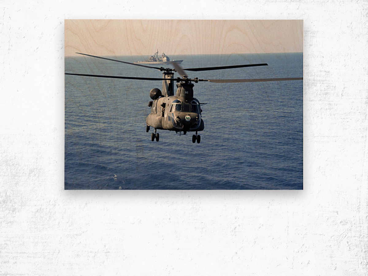 A U.S. Army MH-47 Chinook prepares to land. Wood print