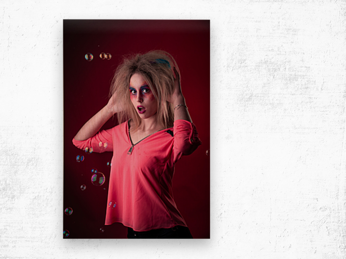 Attractive young girl with disheveled hair  Wood print
