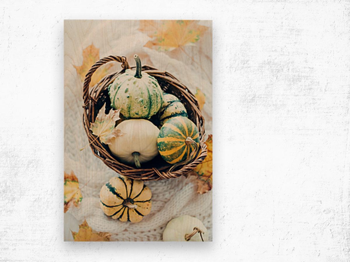Autumn pumpkins in a basket Wood print