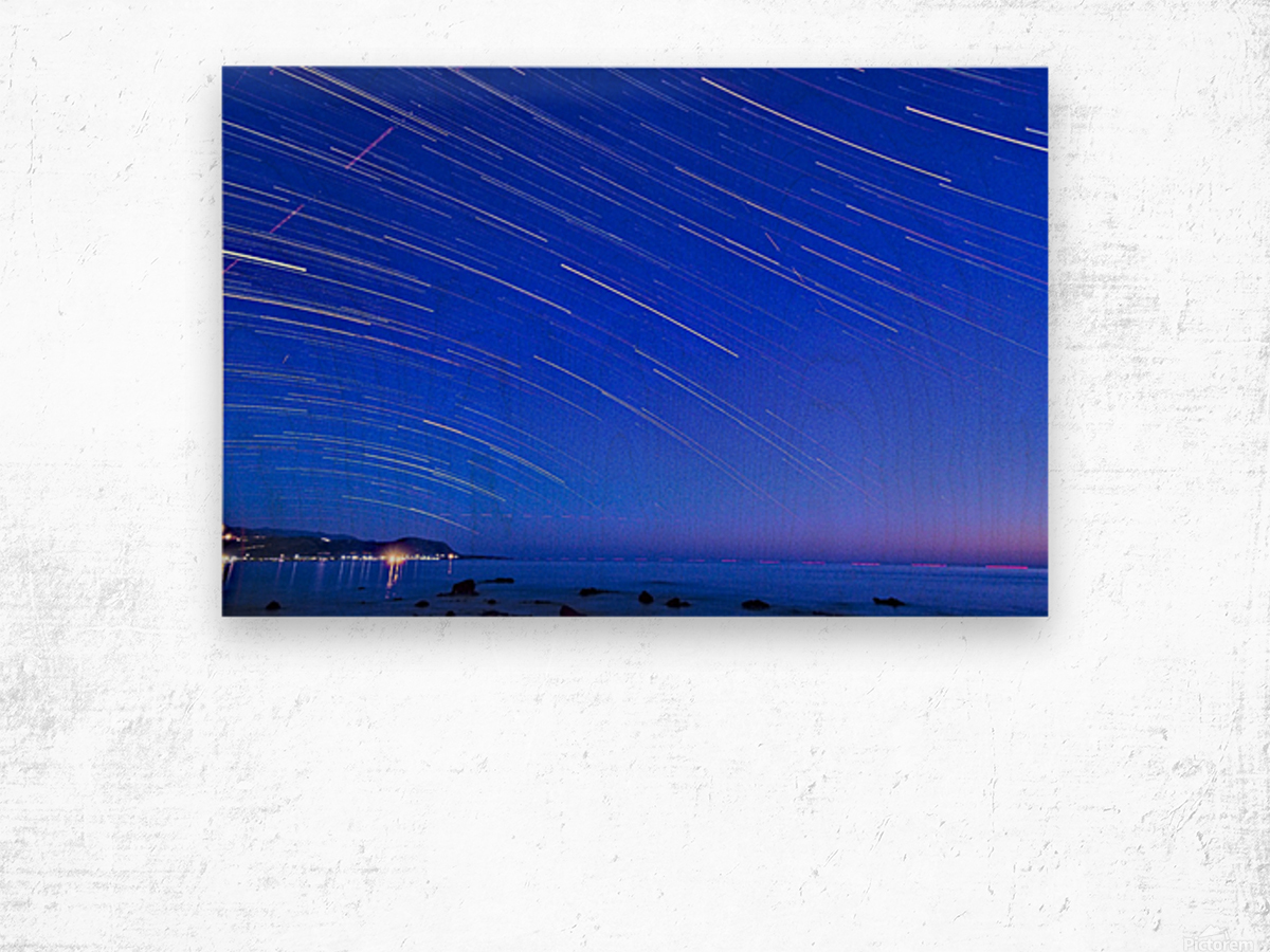 Dive of stars in the sea Wood print