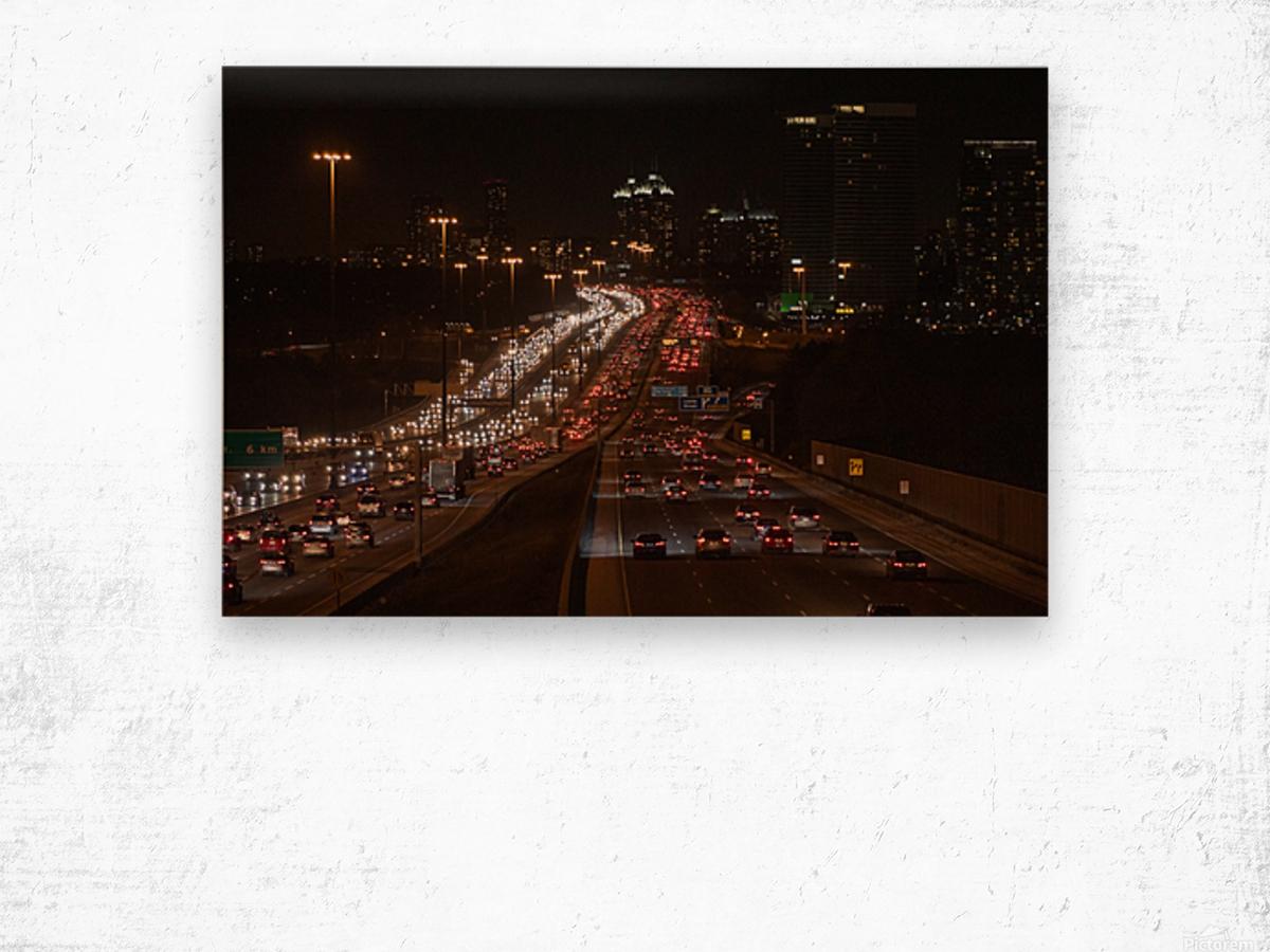 Busy road at night Wood print