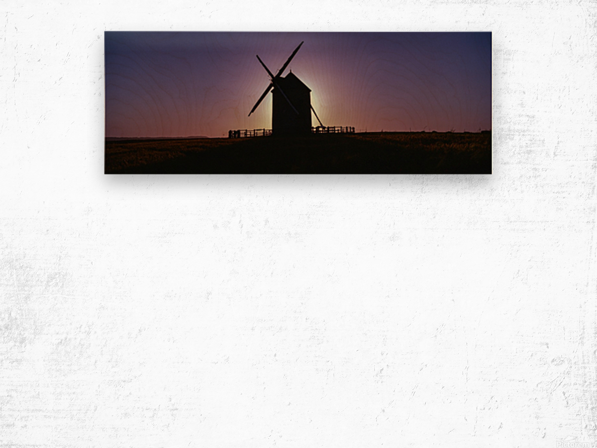 Windmill against the sunset north west France. Wood print