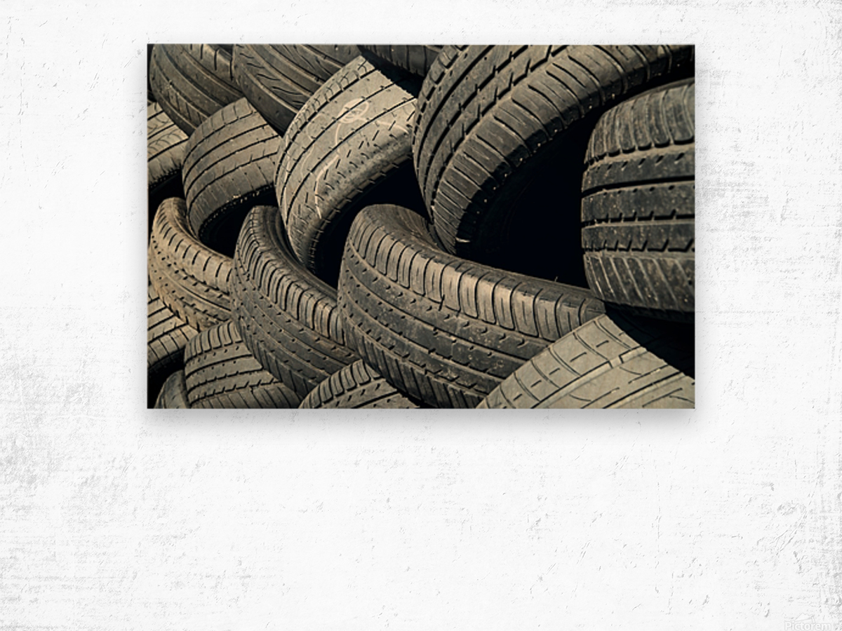 Tires stacked for recycling Wood print