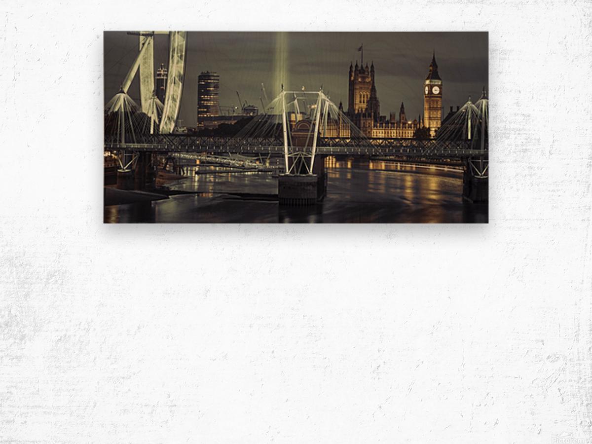 Night view of the London Eye, Golden Jubilee bridge and Westminster, London, UK Wood print