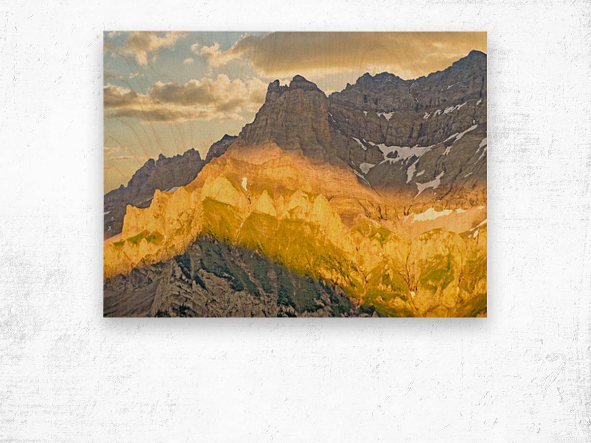 Golden Rays of the Sun Across the Swiss Alps Wood print