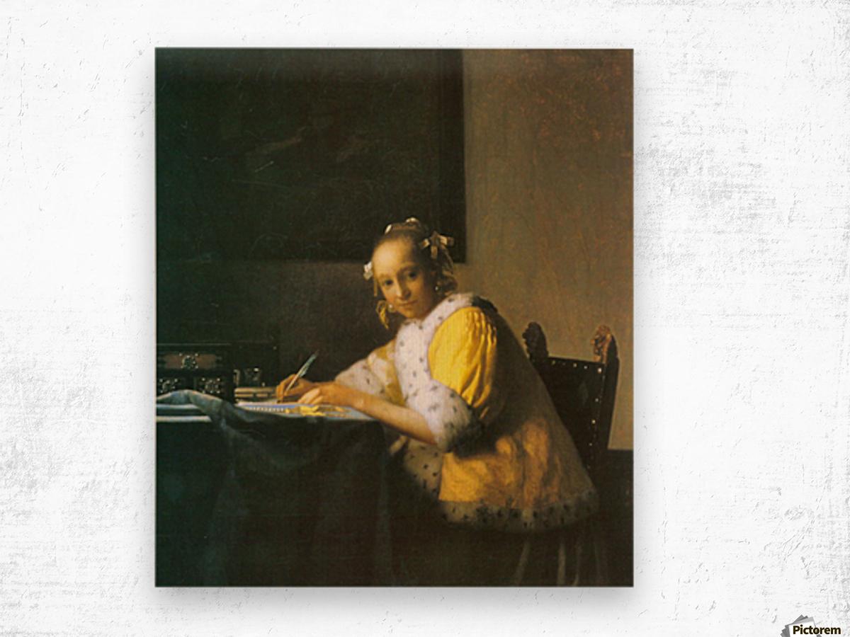 Woman in yellow by Vermeer Wood print