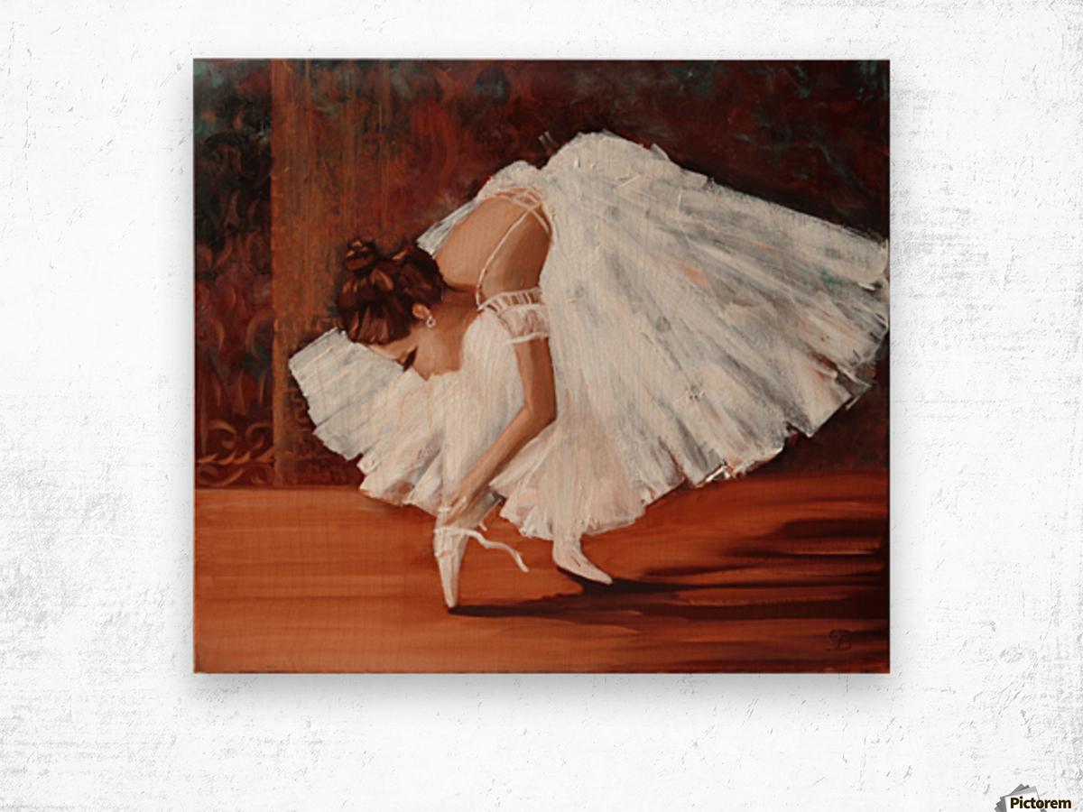 Ballerina fixing her slippers Wood print