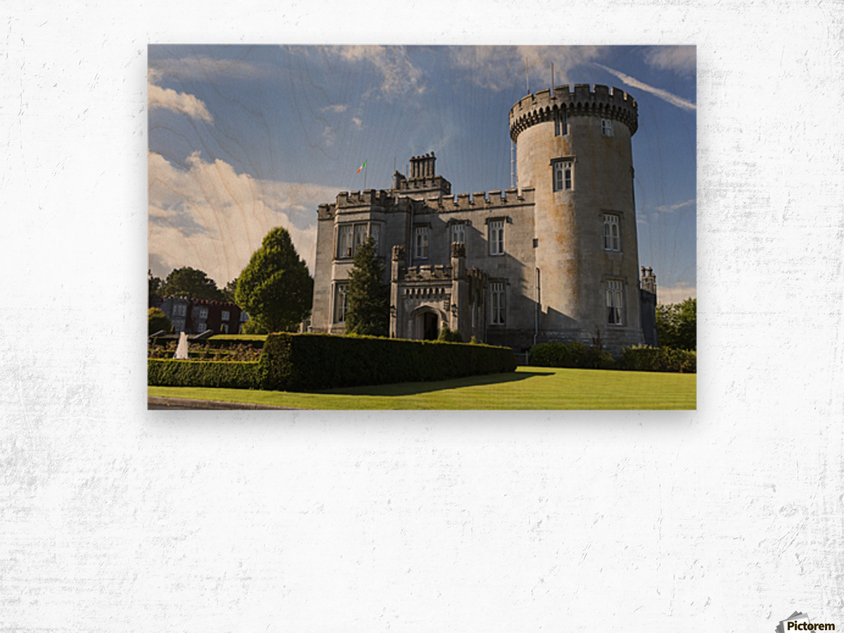 Stone castle with turret, manicured grass, gardens, fountain, blue sky and clouds; County Clare, Ireland Wood print