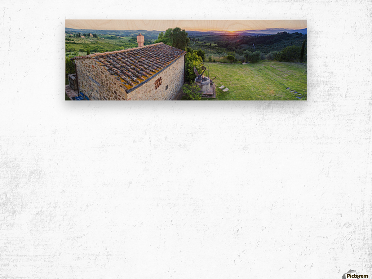 A stone house and a view of the lush landscape at sunset, Villa Capanuccia; Florence, Italy Wood print
