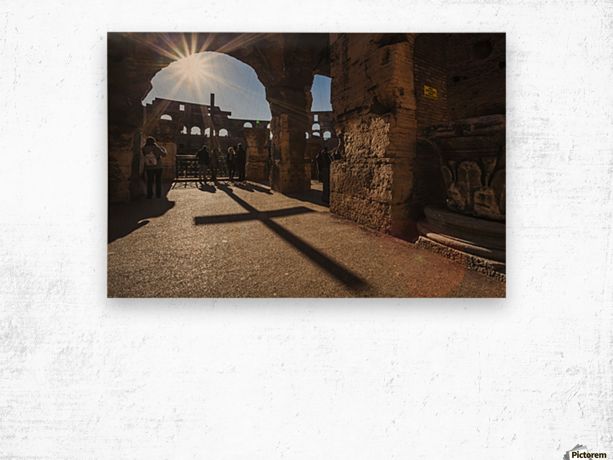 Sunburst through an archway at the Colosseum and a shadow of a cross; Rome, Italy Wood print