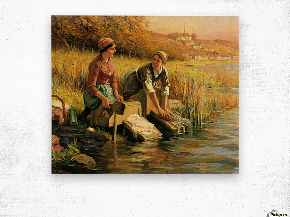 Women washing clothes by a stream Wood print