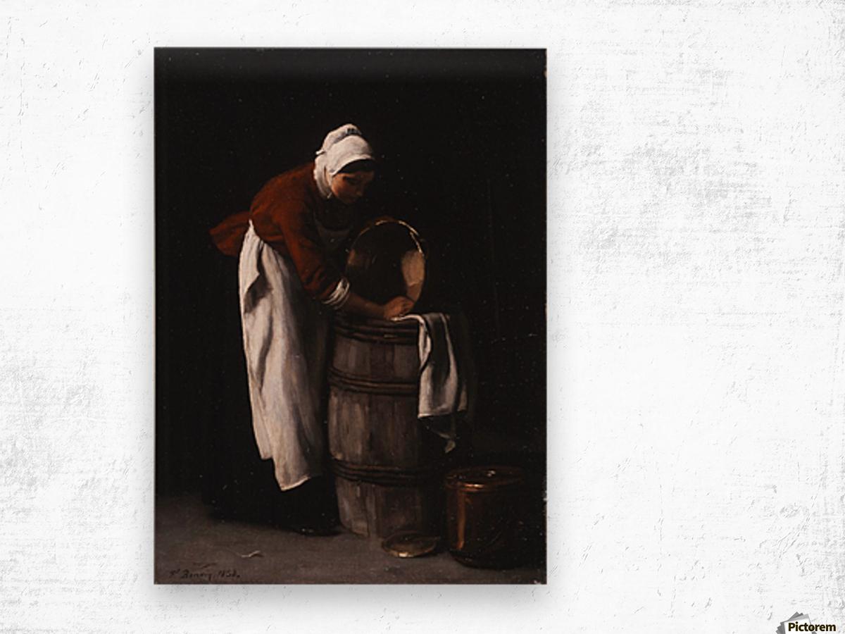 A woman cleaning a barrel Wood print