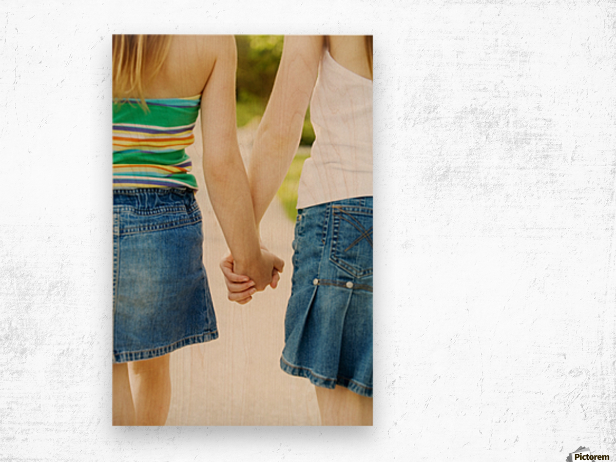 Rear View Of Girls Holding Hands Wood print