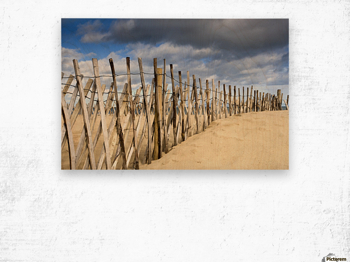 South Shields, Tyne And Wear, England; Dark Clouds Over Fence On A Beach Wood print