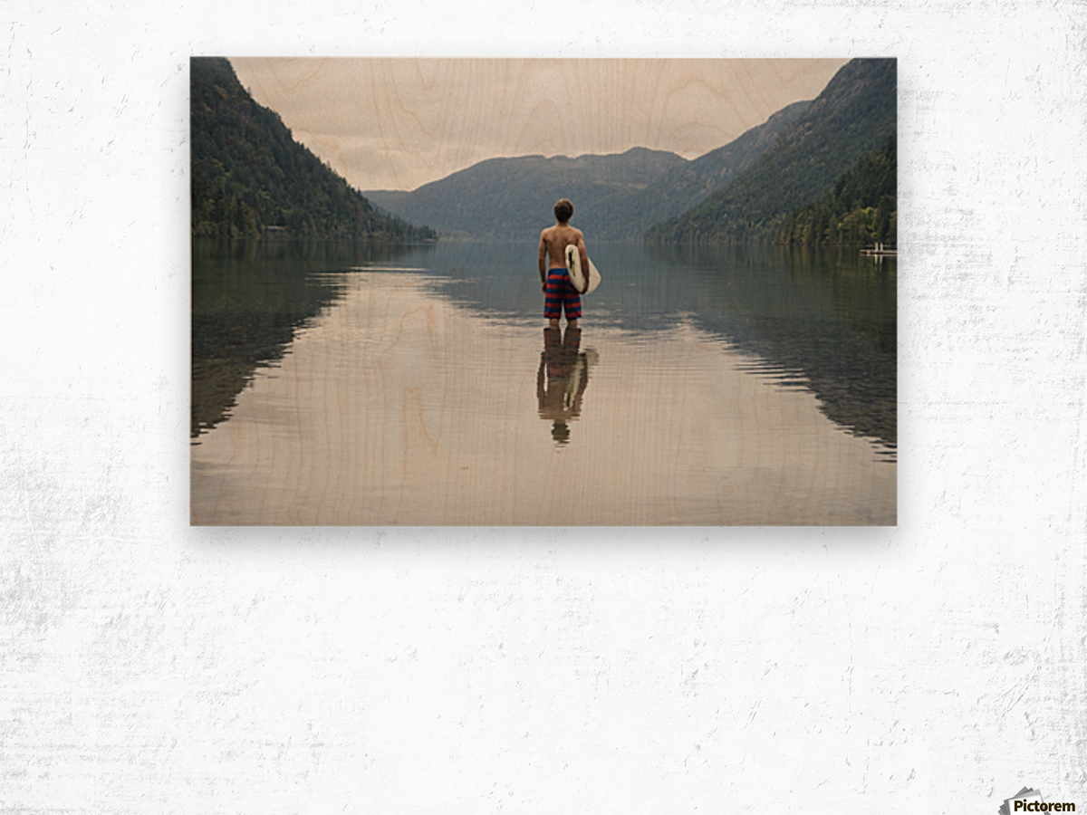 A Young Man Wearing A Swimsuit Stands In Cameron Lake; British Columbia Canada Wood print