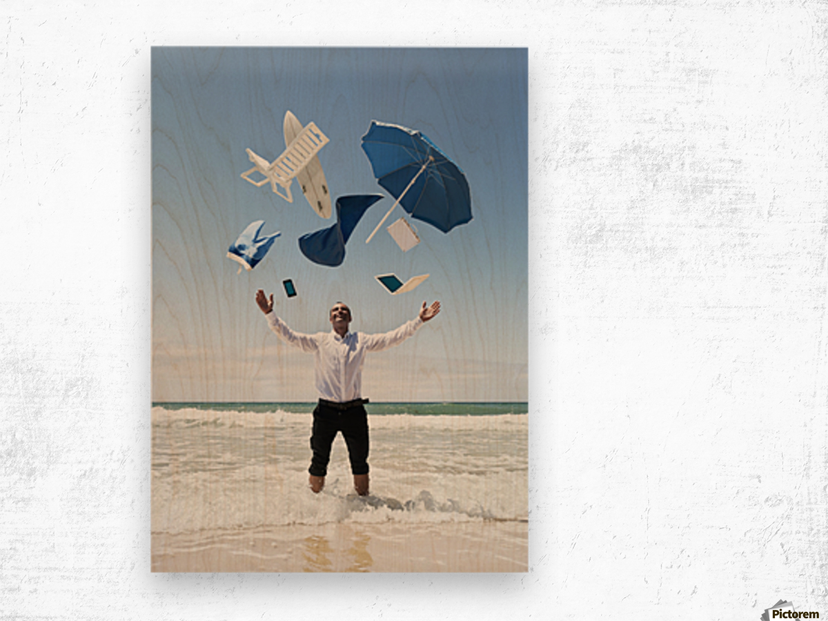 A Man Stands In The Ocean With Items From Work And Vacation Flying Over His Head; Tarifa, Cadiz, Andalusia, Spain Wood print