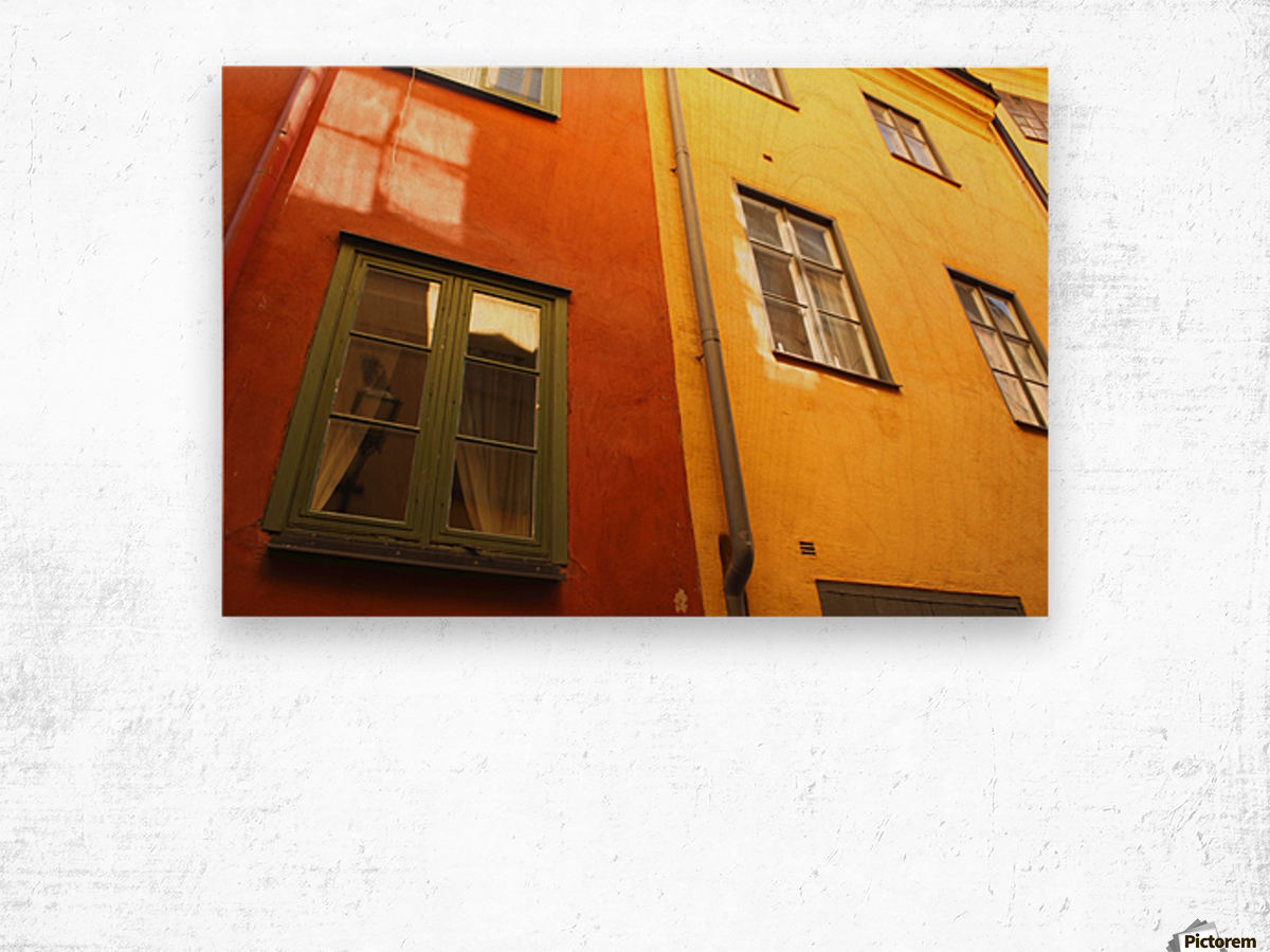 Low Angle View Of Red And Yellow Painted Buildings; Stockholm, Sweden Wood print