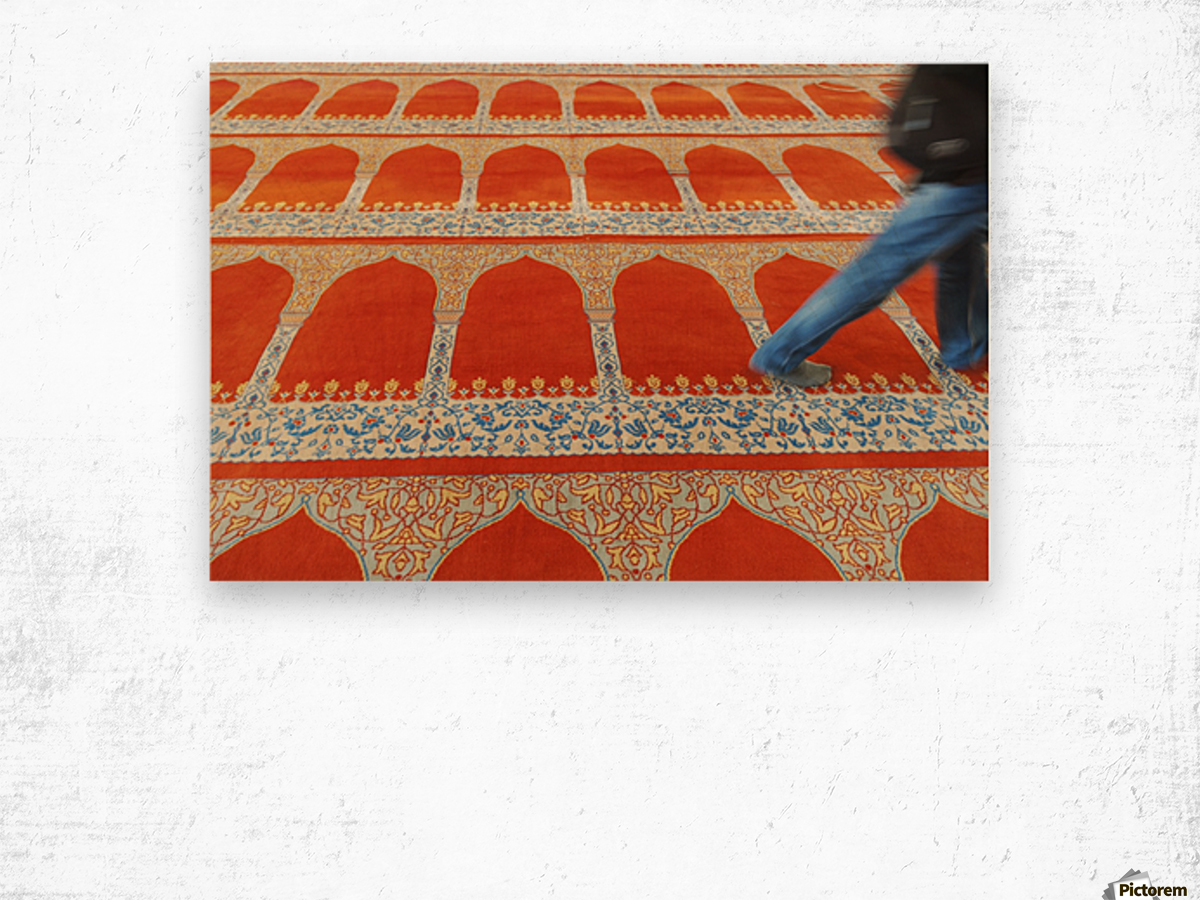 A person walking over the colourful carpet in the suleymaniye mosque;Istanbul turkey Wood print
