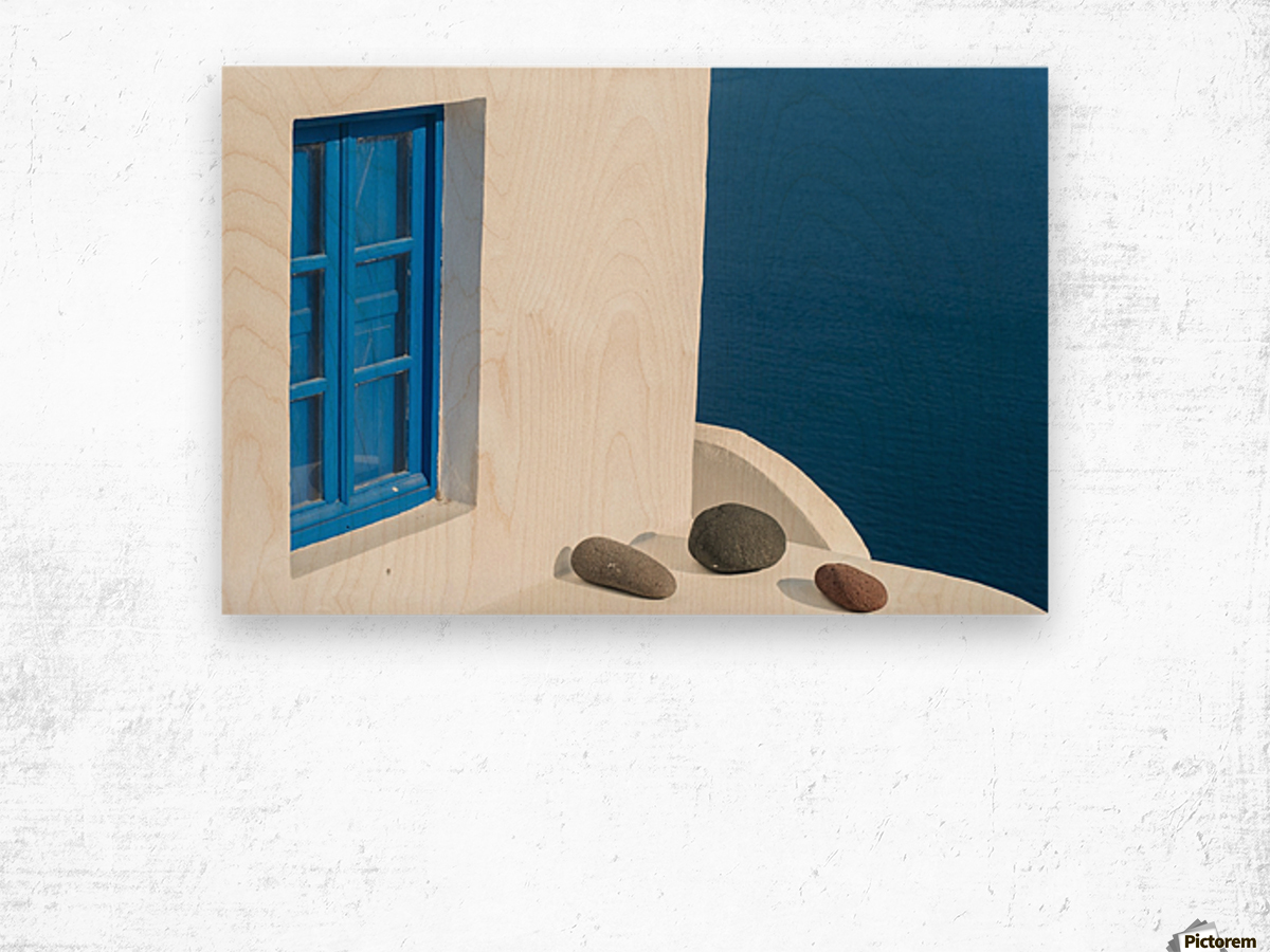 Whitewash building with blue trimmed window along the Aegean sea; Oia, Santorini, Greece Wood print