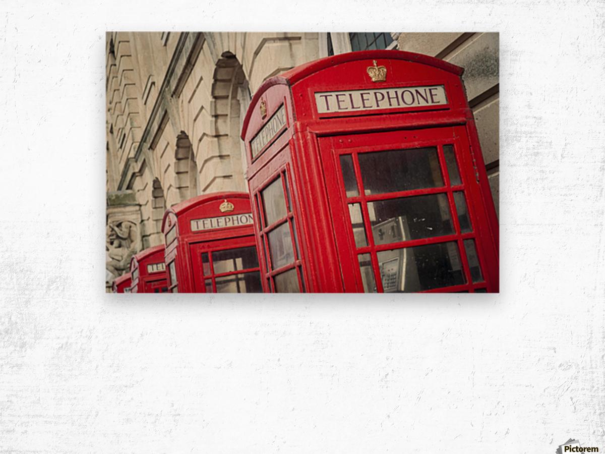 Telephone boxes in a row; Blackpool, Lancashire, England Impression sur bois