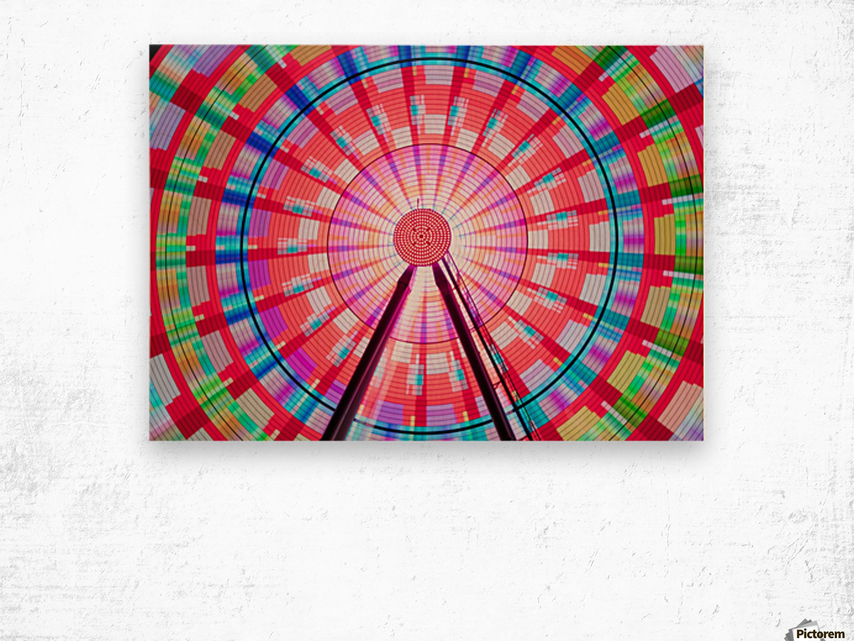 Long exposure photograph showcasing the many color combinations the Big Wheel produces at night; Seattle, Washington, United States of America Wood print