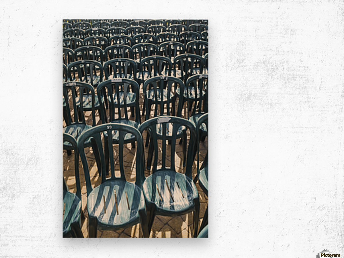 Plastic green chairs lined up in rows; Malaga Province, Andalusia, Spain Wood print
