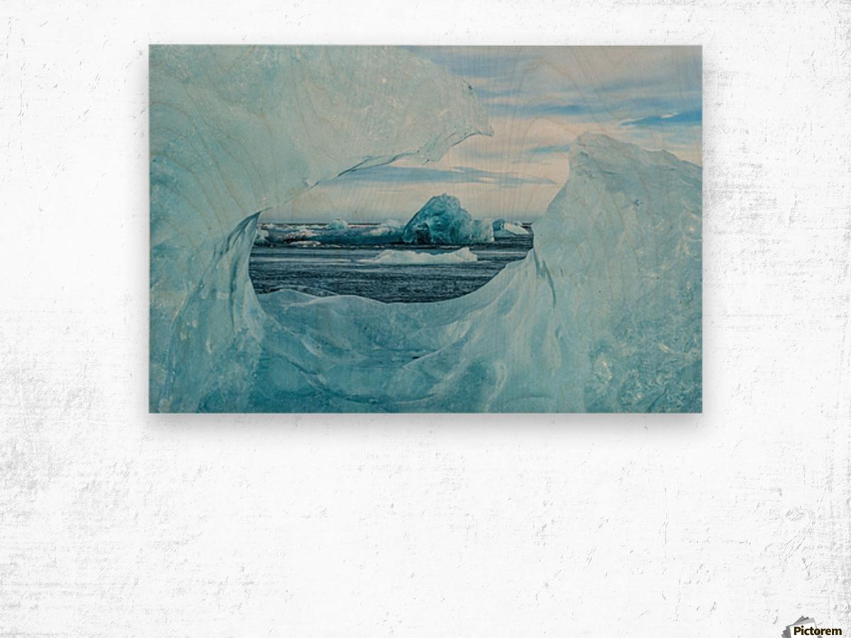Icebergs on the southern beach near the ice lagoon of Jokursarlon; Iceland Wood print